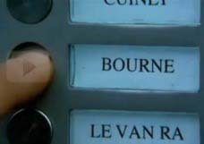 Jason Bourne ringing the bell of his apartment